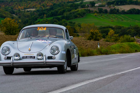 CAGLI, ITALY - OCT 24 - 2020: PORSCHE 356 1600 COUPÉ 1956 on an old racing car in rally Mille Miglia 2020 the famous italian historical race (1927-1957)
