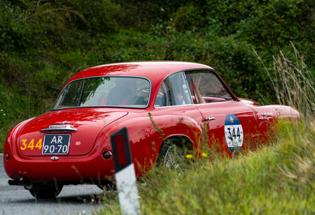CAGLI, ITALY - OCT 24 - 2020: ALFA ROMEO 1900 C SUPER SPRINT TOURING 1955 on an old racing car in rally Mille Miglia 2020 the famous italian historical race (1927-1957)