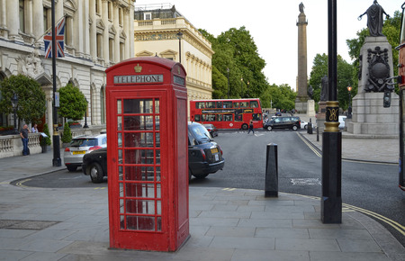 London, United Kingdom, 14 June 2018. London's telephone booths are one of the city's symbols. Classically of strictly red color. More rarely in black.