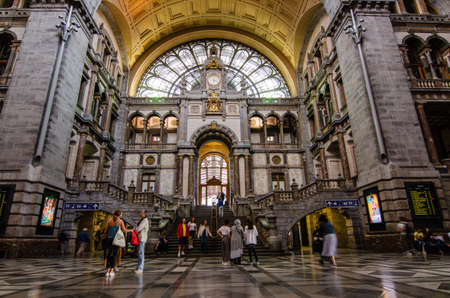 Antwerp, Flanders, Belgium. August 2019. The historic entrance hall of the central railway station is so large and finely decorated that it earns the title of cathedral of the stations. People.