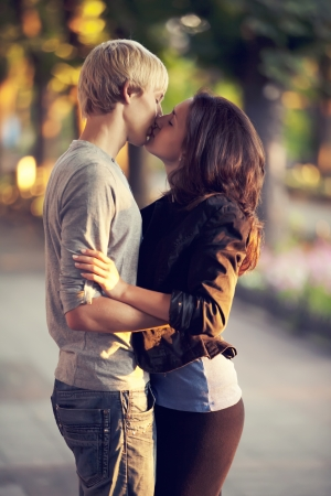 Photo for Young couple kissing on the street - Royalty Free Image