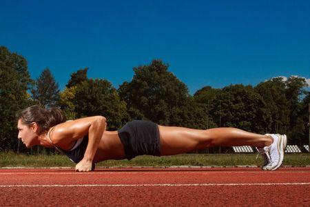 Foto für Athletic woman working out on track - Lizenzfreies Bild