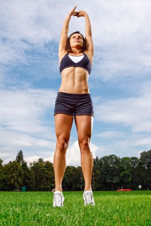 Athletic woman working out on field
