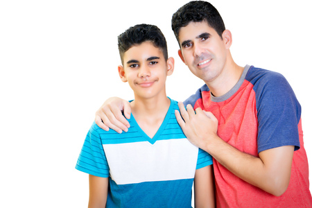 Photo pour Latin father and his teenager son isolated on white - image libre de droit