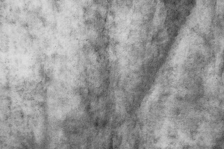 Black and white strongly crumpled background or paper texture