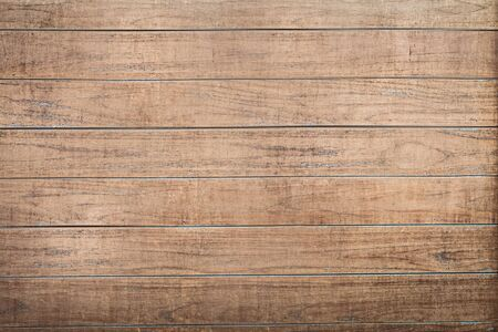 Photo pour The wall of the house is covered with brown wooden boards .Texture or background - image libre de droit
