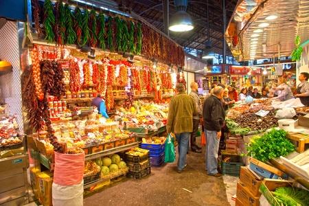 BARCELONA, SPAIN : Tourists shop in famous La Boqueria market