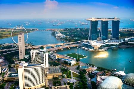 Foto für Fish-eye view of Singapore city skyline at sunset.   - Lizenzfreies Bild