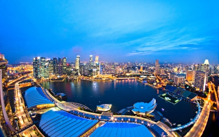 Photo for Fish-eye view of Singapore city skyline at sunset.   - Royalty Free Image