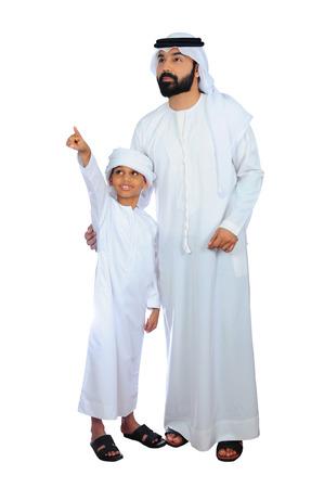 Photo pour Arab Father And Son Going For Shopping - image libre de droit