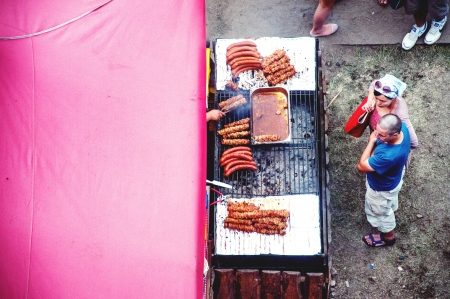 SZCZECIN - AUGUST 04: Visitors qued for grilled sasuage at lunch time during The Tall Ships Races 2013, August 04, 2013 in Szczecin, Poland.