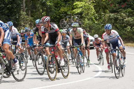 GOMBAK, SELANGOR - MARCH 14 : Big peloton at KM 68, Gombak, Selangor during stage 7 Le Tour de Langkawi 2015 from Shah Alam to Fraser Hill, Pahang Malaysia on March 14, 2015.