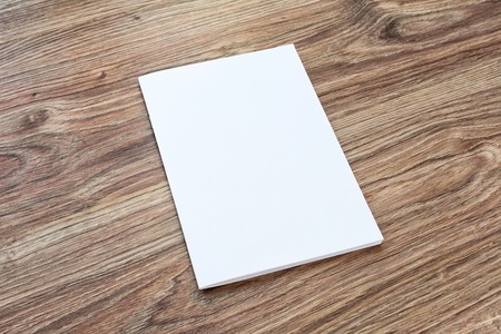 Photo for Blank of brochure is on a wooden desk. Template for your design. - Royalty Free Image