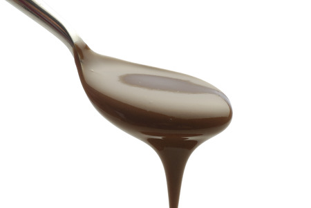 cuillire flowing chocolate on white background