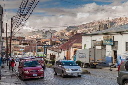 LA PAZ, BOLIVIA - APRIL 23, 2015: Traffic on Uruguay street in the center of La Paz, Bolivia.