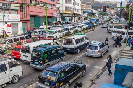 LA PAZ, BOLIVIA - APRIL 23, 2015: Traffic on a main road Avenida Ismael Montes in La Paz, Bolivia.