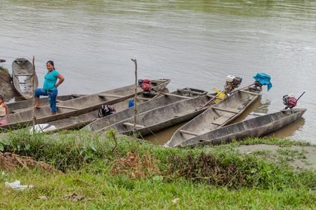 PANTOJA, PERU - JULY 9, 2015: Villagers on a dugout canoe called Peke Peke on a river Napo, Peru