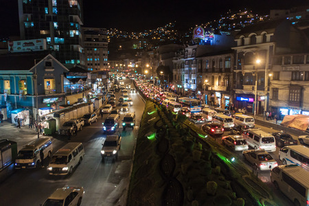 LA PAZ, BOLIVIA - APRIL 28, 2015: Traffic on a main road Avenida Ismael Montes in La Paz, Bolivia.