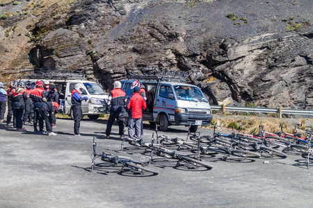 LA CUMBRE, BOLIVIA: APRIL 29, 2015: Bicycles and participants prepared for descent of The World's most dangerous road at La Cumbre pass (altitude 4700 m) in Bolivia.