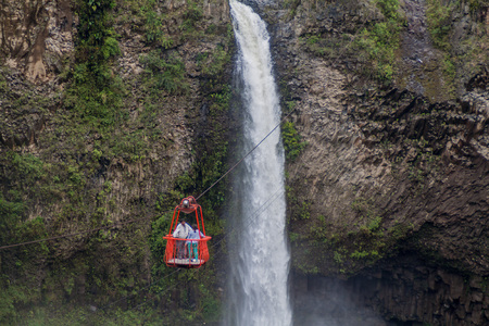 BANOS, ECUADOR - JUNE 22, 2015: Cable car is used for observing Manto de la Novia (Bridal Veil) waterfall near Banos, Ecuador