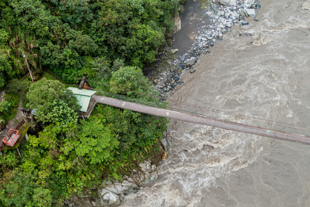 Suspension bridge over Pastaza river in Ecuador