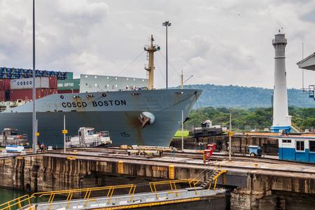 GATUN, PANAMA - MAY 29, 2016: Container ship passes through Gatun Locks, part of Panama Canal.