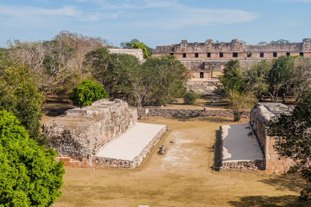 Ball court (Juego de Pelota) and Nun's Quadrangle (Cuadrangulo de las Monjas) in the background at the ruins of the ancient Mayan city Uxmal, Mexico