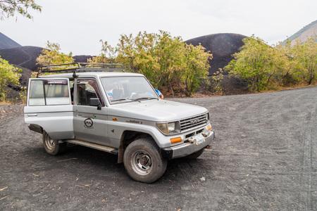 CERRO NEGRO, NICARGAUA - APRIL 26, 2016: 4WD vehicle carrying tourists to Cerro Negro volcano, Nicaragua. Volcano boarding is a popular activity here.