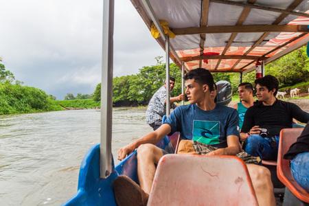 LA SUERTE, COSTA RICA - MAY 14, 2016: Passengers of a boat traveling from La Pavona to Tortuguero on La Suerte river.
