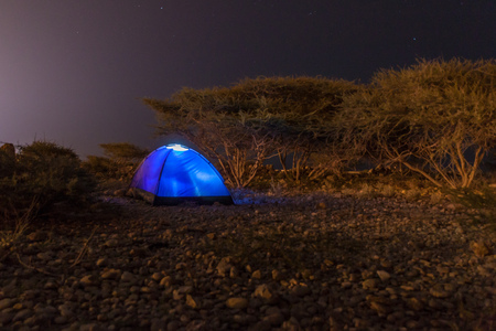 Photo for Nigh view of a tent on a rocky landscape of Oman - Royalty Free Image