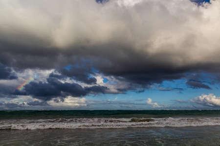 Photo pour Rainbow and clouds at a sea - image libre de droit