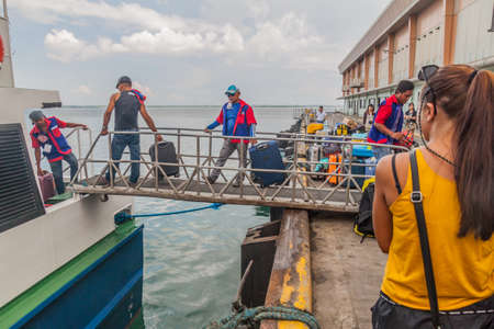 Photo for CEBU, PHILIPPINES - FEBRUARY 12, 2018: Ferry undloading at  the Passenger Terminal in Cebu, Philippines - Royalty Free Image