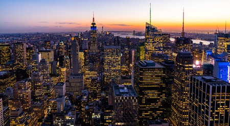 Foto de New York Skyline Manhatten Cityscape Empire State Building from Top of the Rock Sunset - Imagen libre de derechos