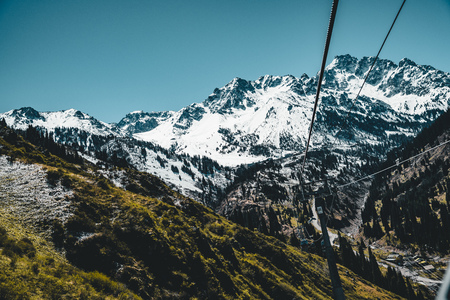 Almaty, Kazakhstan ski lift, cable car cabin at Medeo to Shymbulak route against mountain background