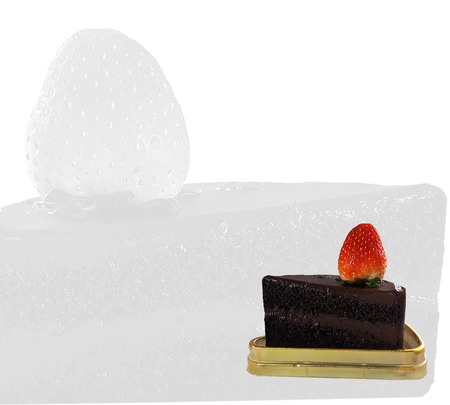 Chocolate cake and Strawberry placed on golden tray on white background
