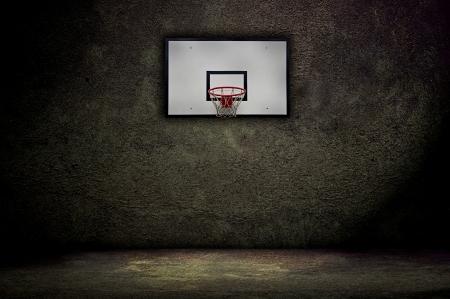 Basketball hoop on empty outdoor court