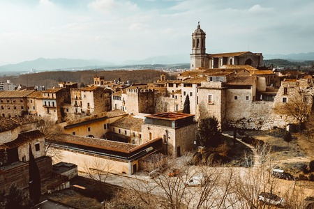 Foto für Cityscape, view of Girona, Catalonia, Spain. The Girona Cathedral, also known as the Cathedral of Saint Mary of Girona is a Roman Catholic church. - Lizenzfreies Bild