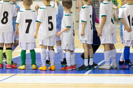 Indoor football soccer match for children. Kids boys starting to play