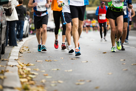 Photo pour Marathon running race, people feet on autumn road - image libre de droit