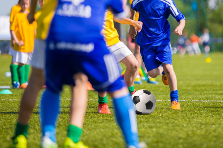 Photo for Teenagers Boys Playing Soccer Football Match. Young Football Players Running and Kicking Soccer Ball on a Soccer Pitch. - Royalty Free Image