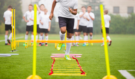 Photo pour Boy Soccer Player In Training. Young Soccer Players at Practice Session - image libre de droit