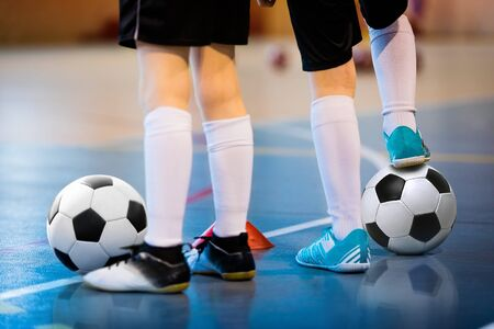 Foto de Futsal soccer training. Two young futsal players with balls on training. Close up of legs of futsal footballers - Imagen libre de derechos
