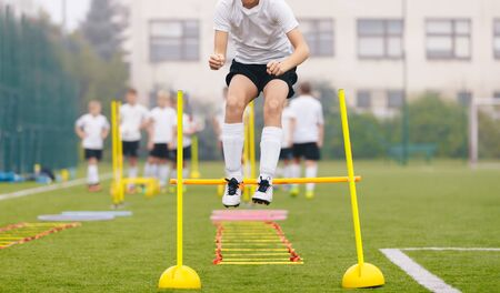 Photo for Footballers on Practice Session in Field on Sunny Day. Soccer Player on Fitness Training. Young Soccer Players at Speed and Agility Practice Training Session - Royalty Free Image
