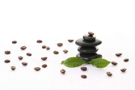 stack of pebbles and coffee beans - beauty treatment