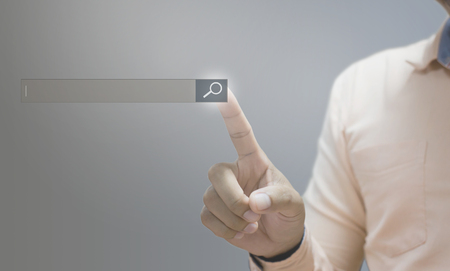 Photo pour Technology  searching system and internet concept  man hand pressing Search button - image libre de droit