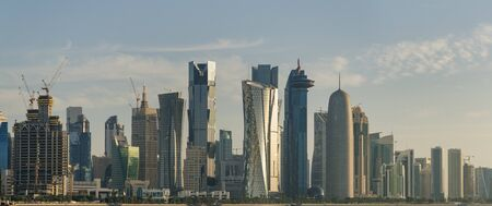Photo pour The futuristic urban skyline of Doha, Qatar. Doha is the capital and largest city of the Arab state of Qatar. West Bay panorama. - image libre de droit