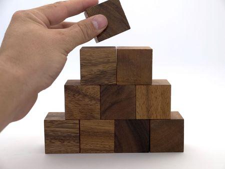 Photo pour Wooden building blocks in the shape of a triangle - image libre de droit