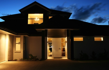 A modern house front entrance at night
