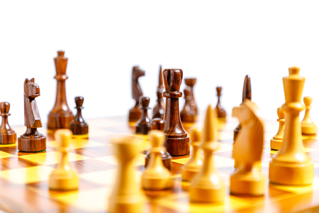 Photo pour Wooden chess pieces on a chessboard with white background - image libre de droit