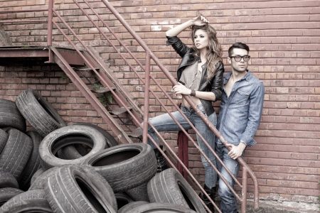 Sexy and fashionable couple wearing jeans, shoot in a grungy location - landscape orientation with copy-spaceの写真素材